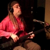 Alan in the studio on fretless electric bass